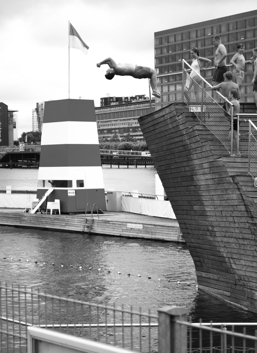 Doing backflips into harbour pools in most cities will cause some nasty guard to yell and scream. In Copenhagen's Island Brygee, people are respected enough to not be babysat by authority.
