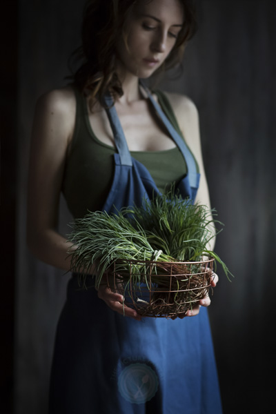 Woman holding agretti, a typical italian spring vegetables