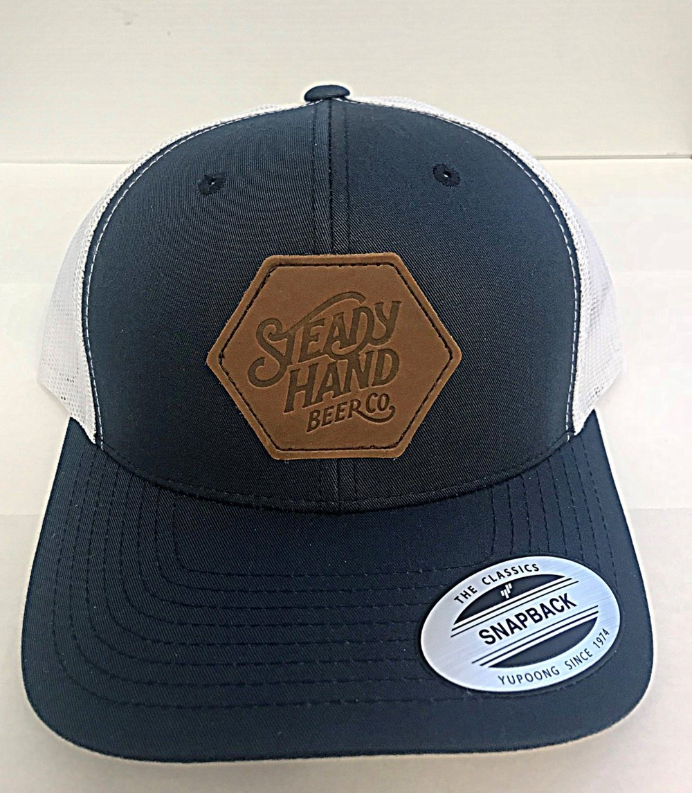 leather patch curved bill trucker multiple color options