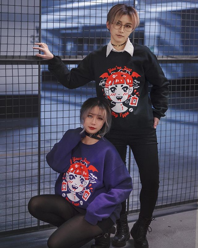 "@yumecos and @kitsurie are quite a pair in our matching ""VAMPY"" sweaters. 👹👹👹 Get one today before it's sold out! Click the link in the bio ➡️➡️➡️ Model: @kitsurie @yumecos  Photo: @xxi.xin"
