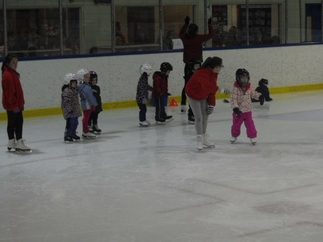 Program Assistants helping with our Learn to Skaters - 2015