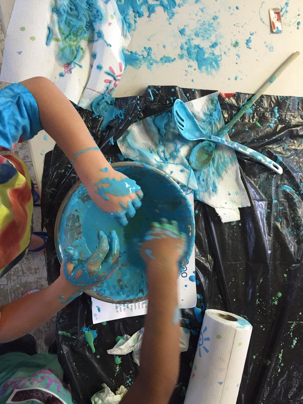 Kids play with cornflour slime at the WMS Let's Make workshop