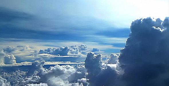 clouds_fly3_slowmo_590x300-2 1.jpg