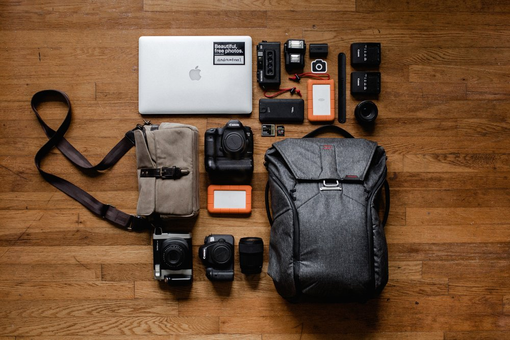 "Lowepro Fastpack - I own an older version of this bag and it is one of my favourite tools. It has lots of compartments for lenses, memory cards, chargers and batteries as well as your camera and a 17"" laptop. Way better for your back too!"