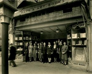 ERNEST DAWSON AND STAFF IN FRONT OF DAWSON'S BOOK SHOP, 1940