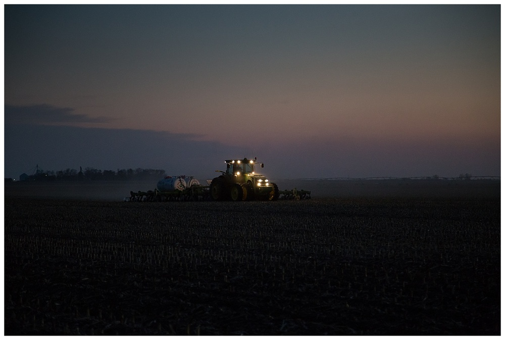 Nebraska farmer fertilizing at night