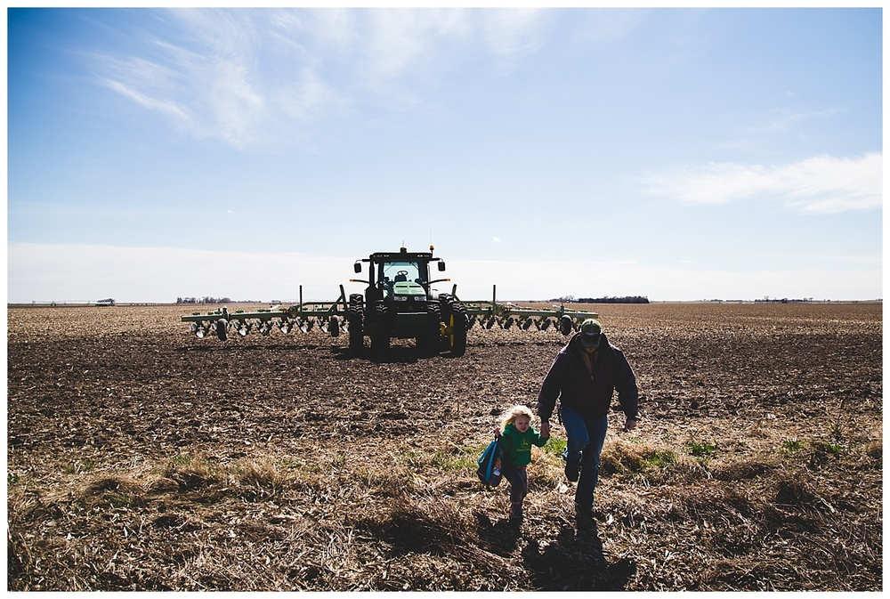 Nebraska farmer with kid