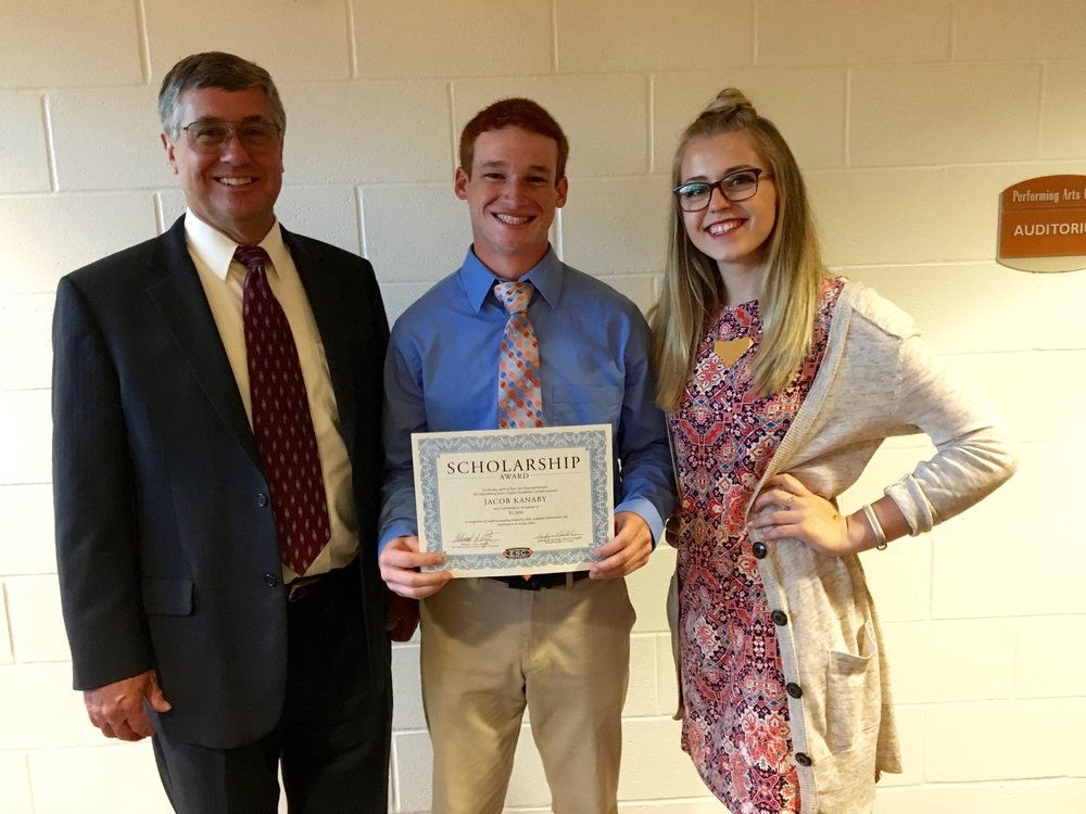 2017 scholarship winner Jacob Kanaby, pictured with Board President Ed Patzer and Executive Director Jennifer Mackling.