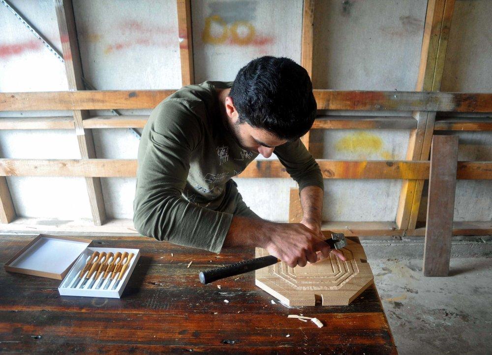 Wood carving, refugee