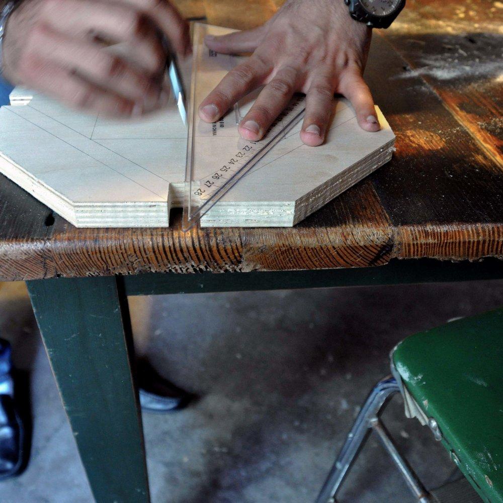 Stool top design for carving, refugee