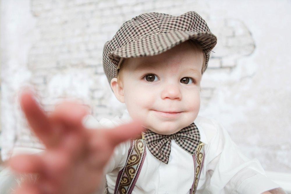 reno newborn photographer baby reaching for camera kristi gayton photography