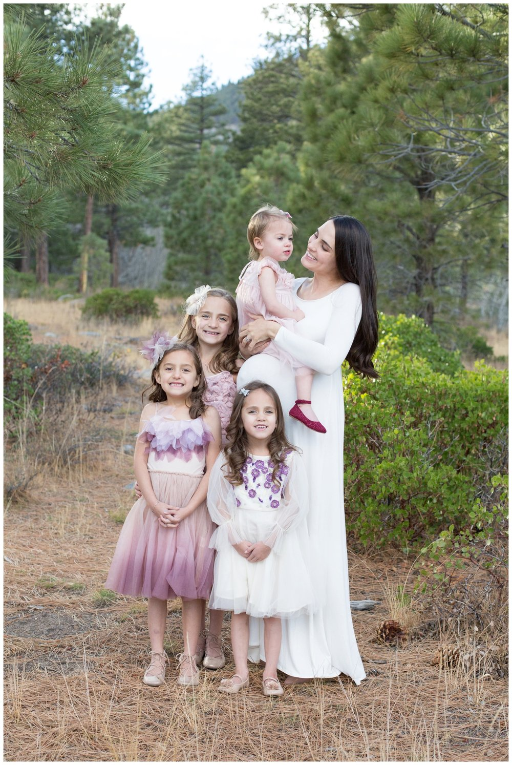 maternity session with sisters in forest