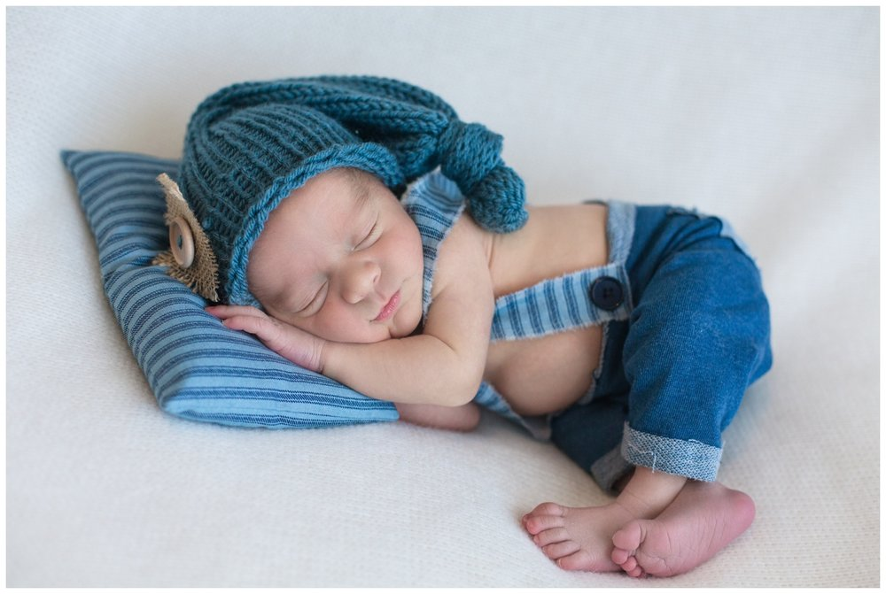 newborn boy blue night hat sleeping