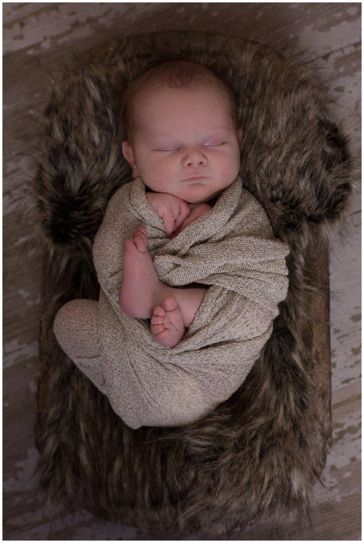 newborn Casey on brown fur flotaki Kristi Gayton photography reno