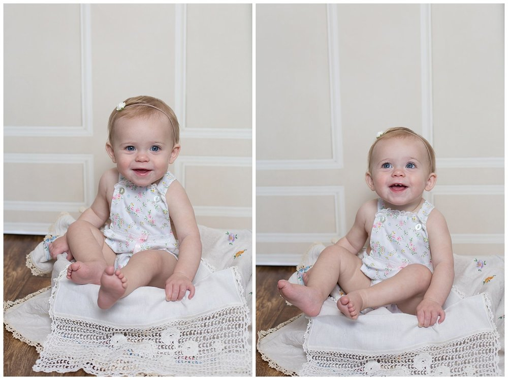 How sweet is she?! Looking adorable in that little floral romper - all smiles and blue eyes! I love these one year sessions! They just grow way too fast- am I right?!