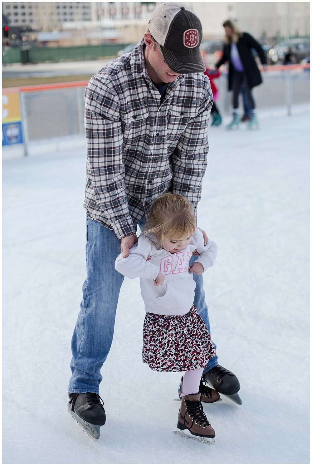 Esme ice skating with Daddy! She had so much fun but the skates were WAY too big so she needed lots of help :)