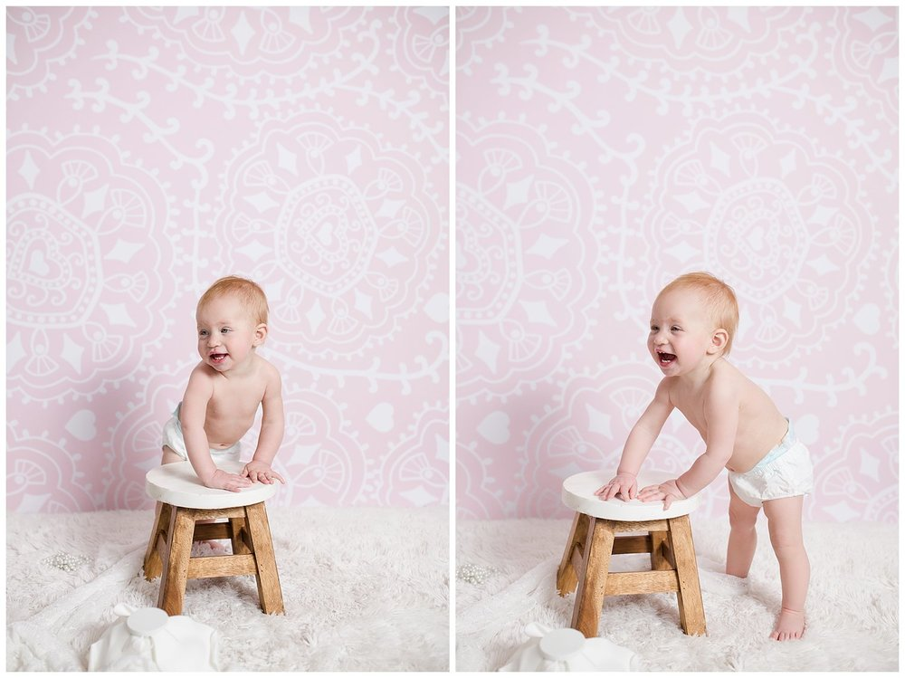 baby Charlotte one year pictures in diaper in studio