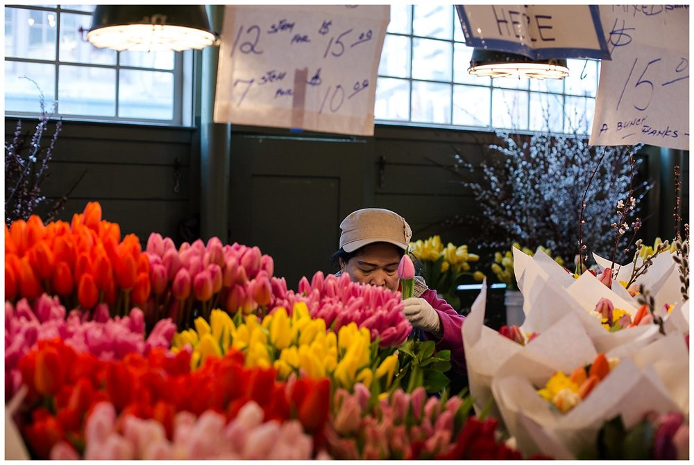 Love this image... just her head peeking out while she works on these bouquets in the pikes place market.