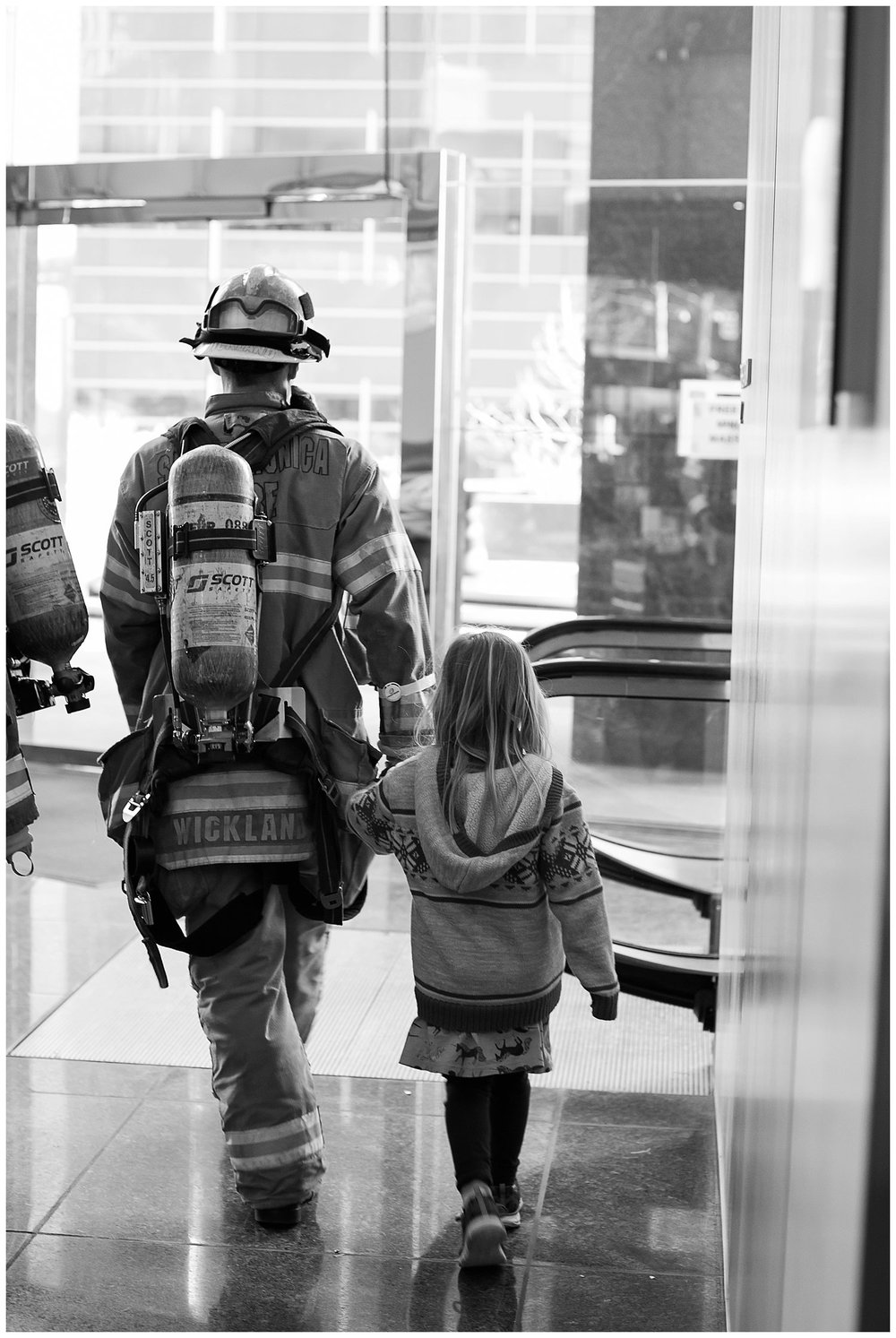 This firefighter wasn't in our group but when I saw him walking out hand in hand with this little girl I thought it was just too darling not to capture! As always thank you for checking out the blog. xo