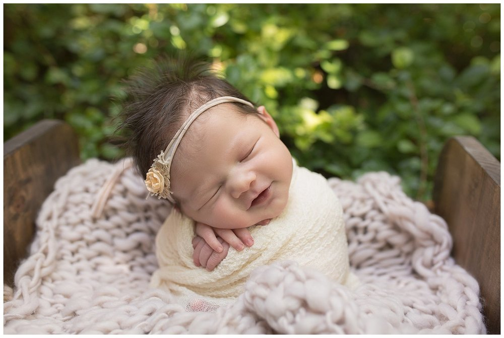 baby girl newborn smiles photography