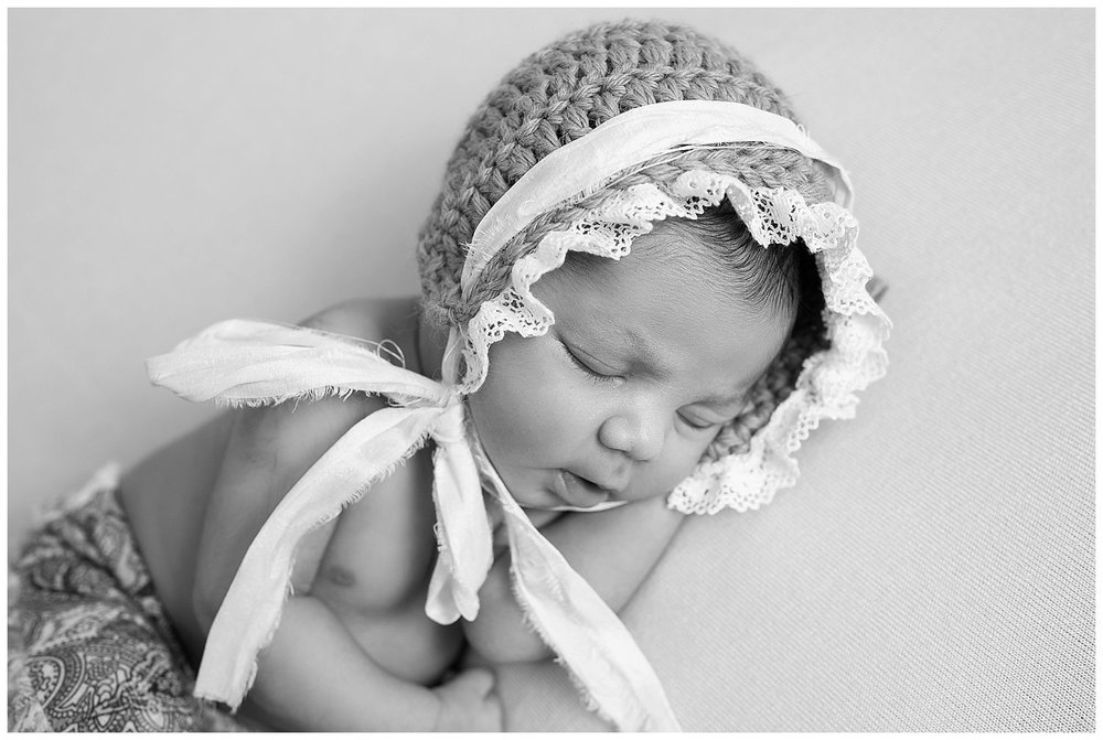 newborn in bonnet