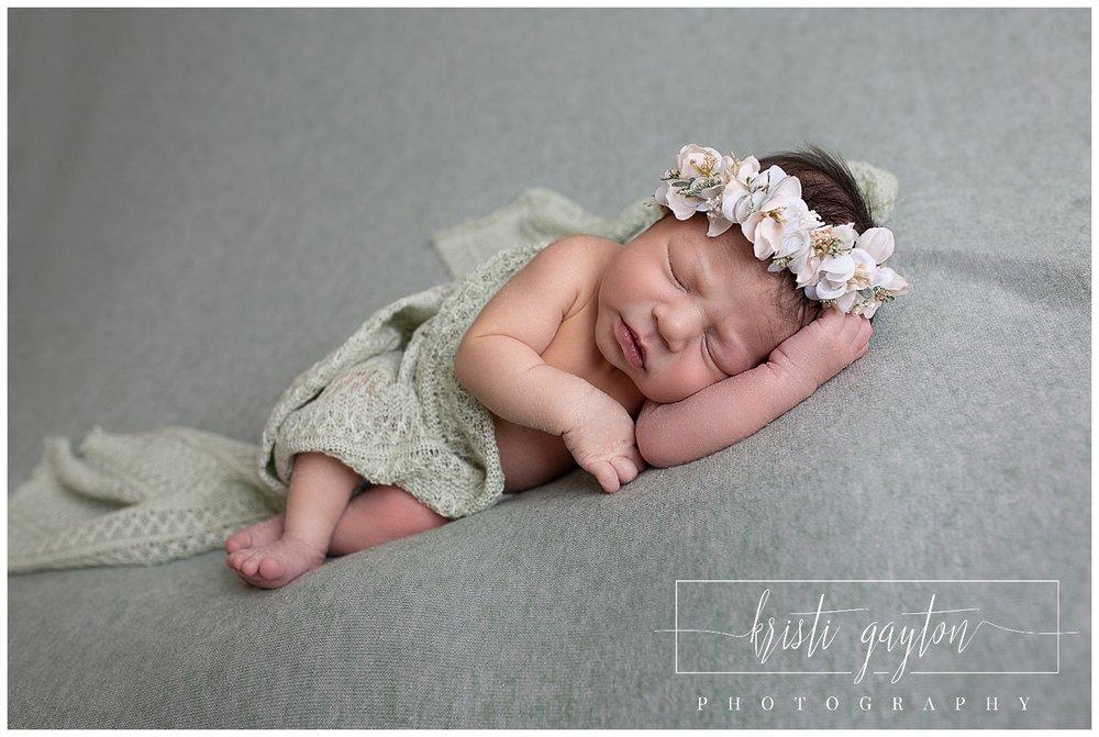 newbornbabygirlwithcrownsagegreenrenonv