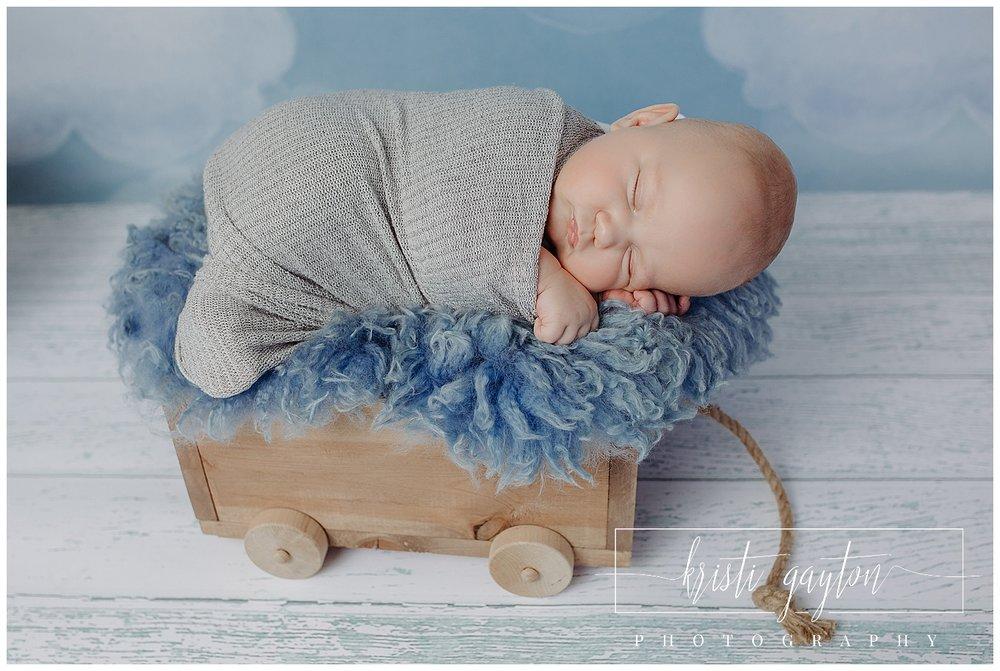 newborn baby in wagon