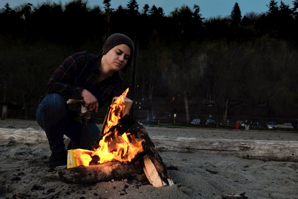 beach fire lady portrait photograph flannel pnw