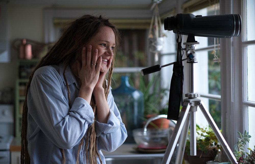 woman portrait Seattle binoculars photograph dreadlocks