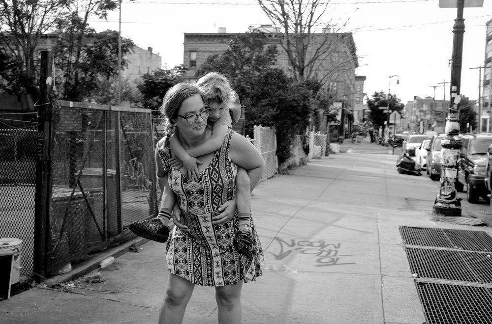 mother child piggyback newyork