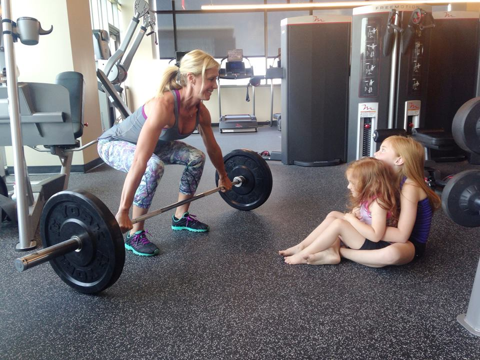 How I Workout - Me with my little reds watching me olympic lifting (not really in this picture). This was a Mother's Day photo for Lululemon.