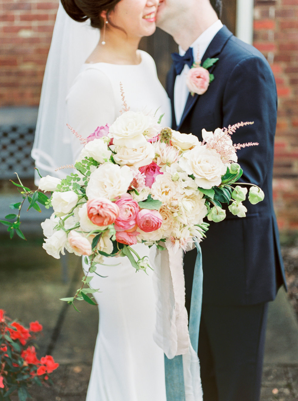 $450 - bridal bouquetGarden Roses, Hellebore, Ranunculus, Maidenhair Fern, Blush Astilbe, White Sweet Pea, White Lisianthus, Jasmine Vine, Blushing Bride, Cotton Candy ScabiosaFinishes: Double 4in/3yd Silk & Willow Silk Hand-Dyed Ribbon
