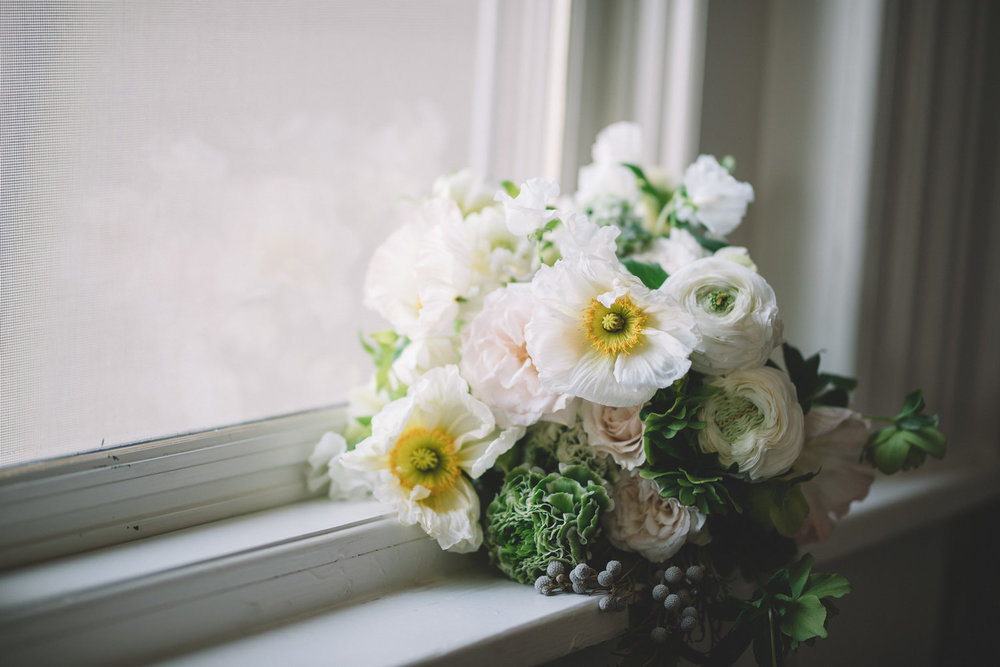 $1500 - the sweet & simple——The perfect package for the couple who is having an intimate wedding with a smaller wedding party size. It also works for the couple who just needs a wedding day flower elements such as a bridal suite, a ceremony installation, or reception florals only. For guest counts of 50.