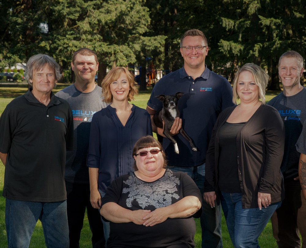 "Meet the Deluxe Heating and Cooling Team! Left to Right: Rick, Dale, Jill, Kathy, Mascot ""Gracie"", Peter, Gina, and Nick."