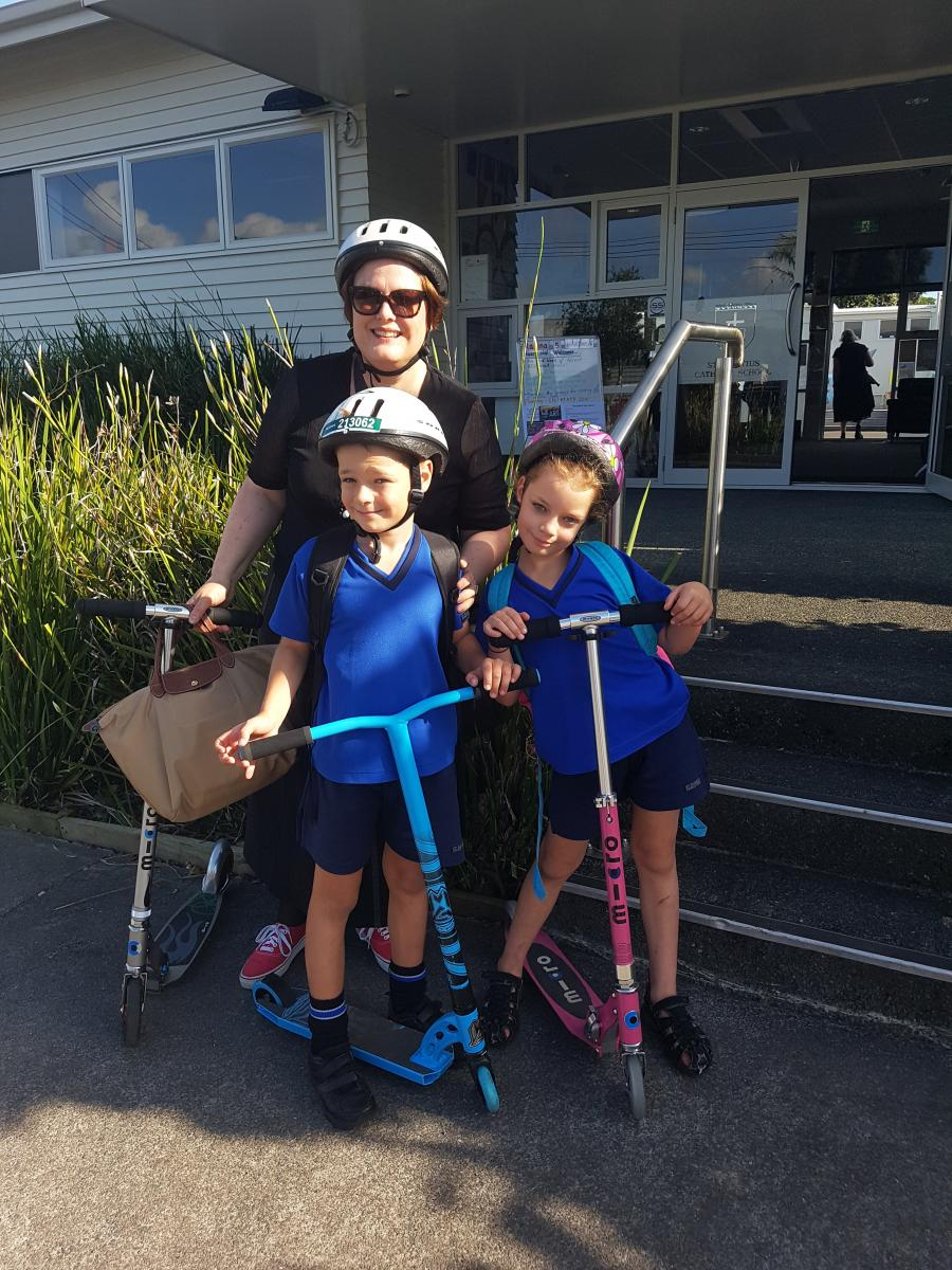 Felicity Buche and her children after riding their scooters to school.