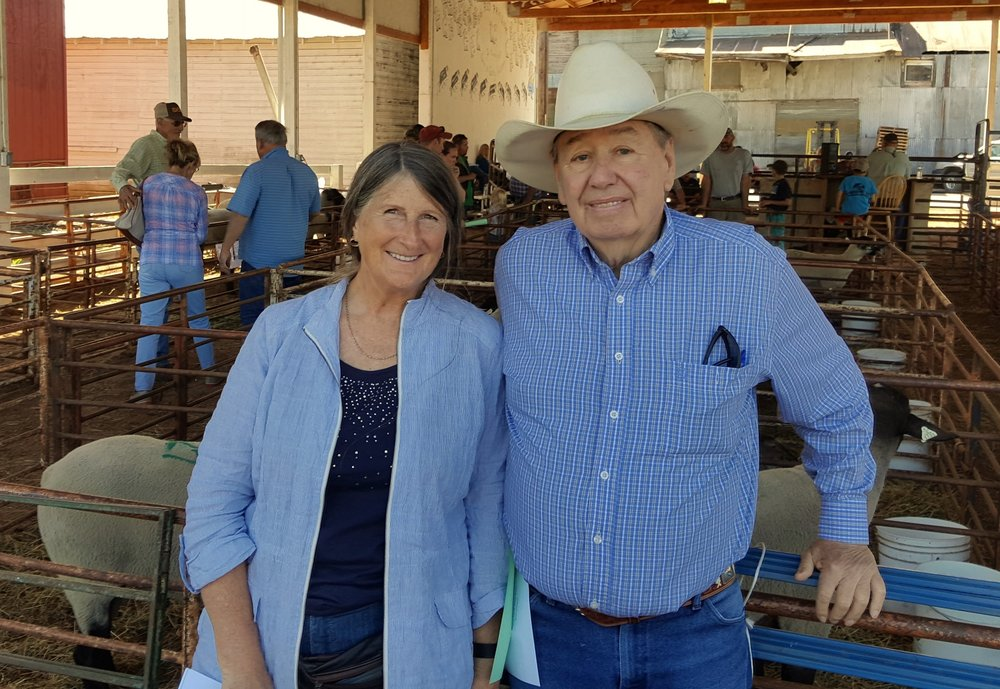 Kathy and Smitty Cox at Scio Ram Show, 2016, buying a new ram.