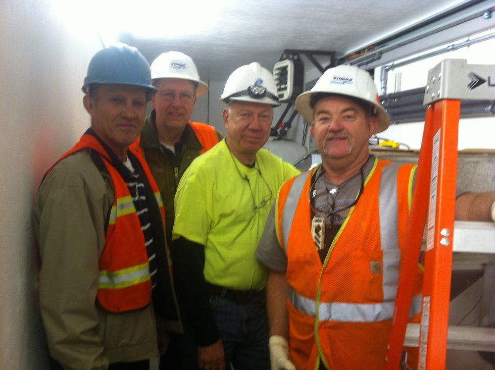 Ken (yellow shirt) with crew at Red Dog Mine, Northwest Arctic Borough, Alaska. Red Dog Mine is the largest zinc mine in the world. This project was to build a pilot facility to remove heavy metals from zinc processing.