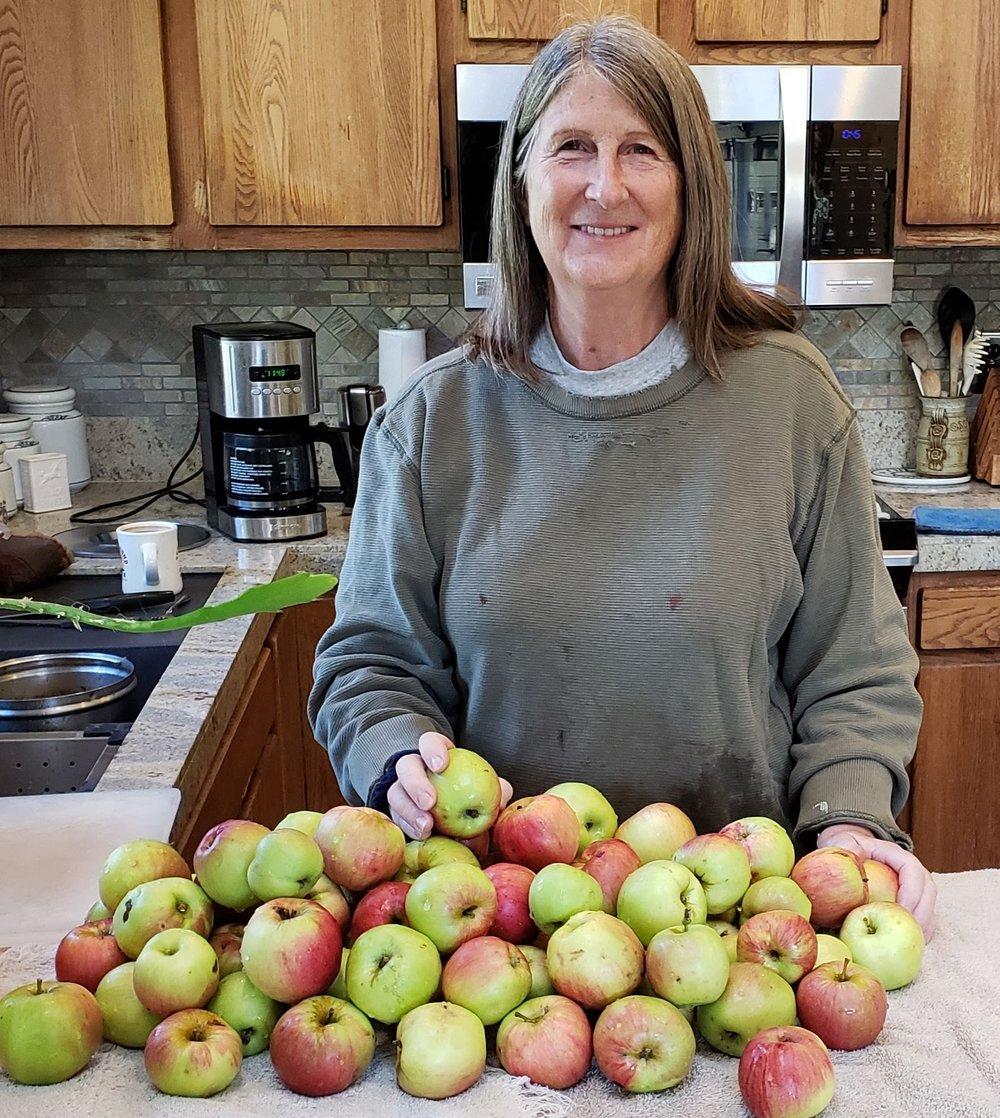 Kathy making applesauce.