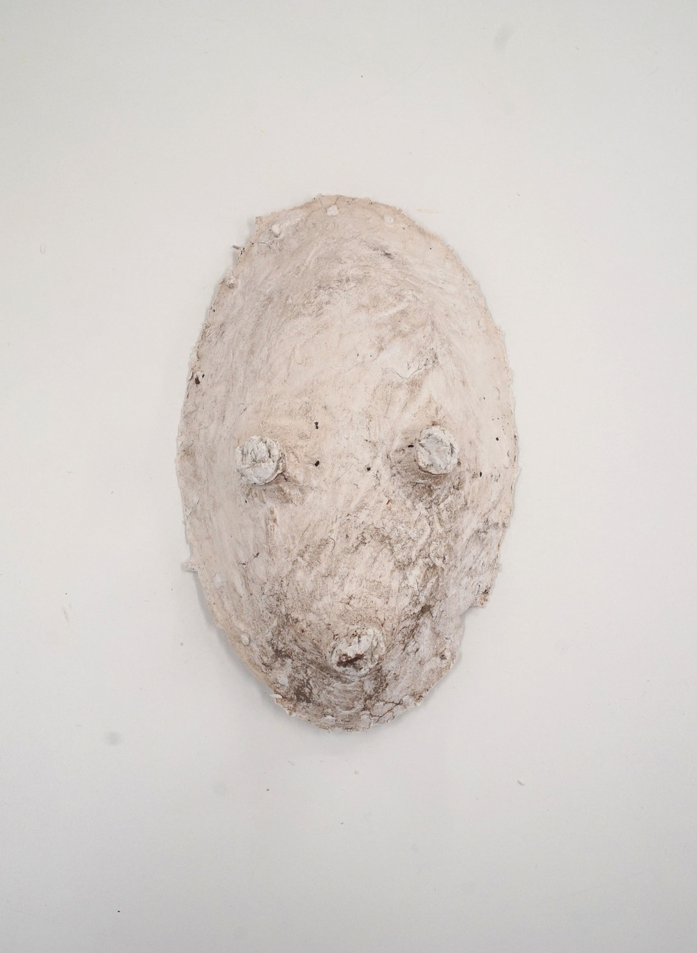 MEL O'CALLAGHAN, Dangerous looking-back, White clay mask, brass hanging system 15cm x 22cm x 10cm, 2015