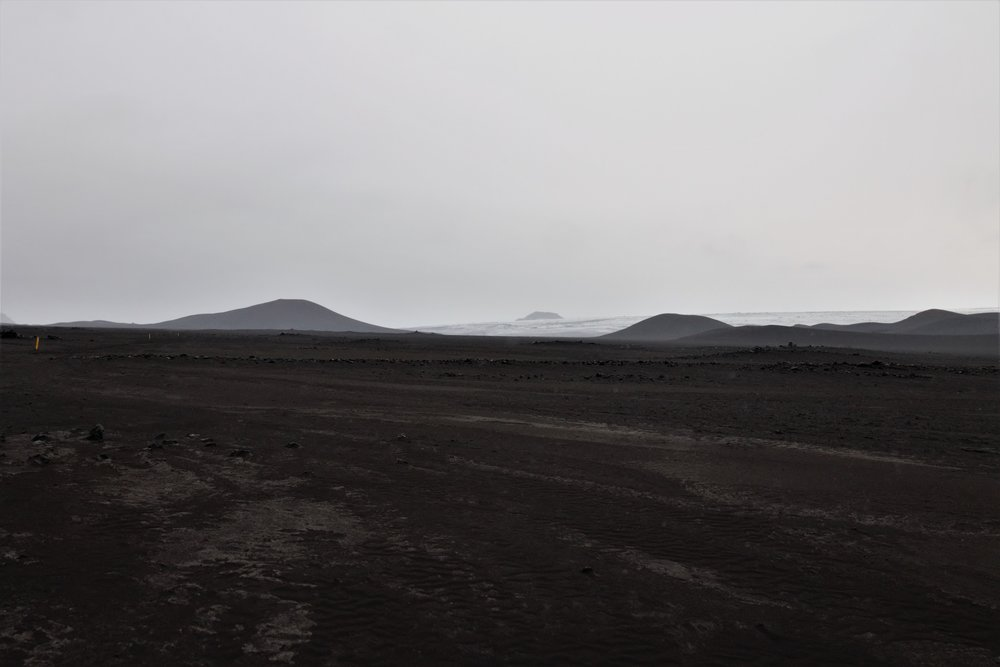 The ash plains. What looks like the ocean in the distance is actually glacier.