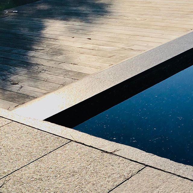 Winter light - granite, teak, water - textures #textures #contemporaryarchitecture #architecturelover #matieres #stone #wood #water #reflections #winterlight #shadows
