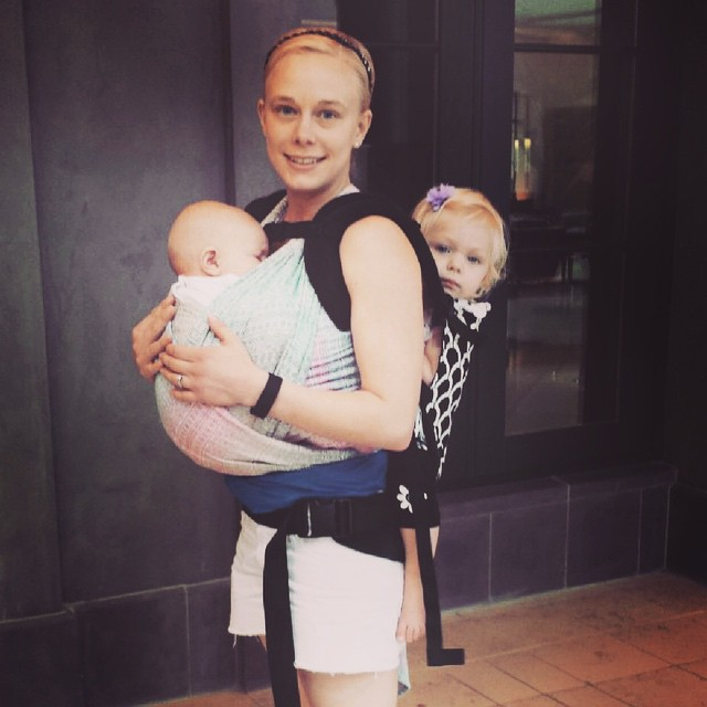 My niece modeling how to tandem carry a toddler and baby. She's got it going on!! #babywearing #getoutside