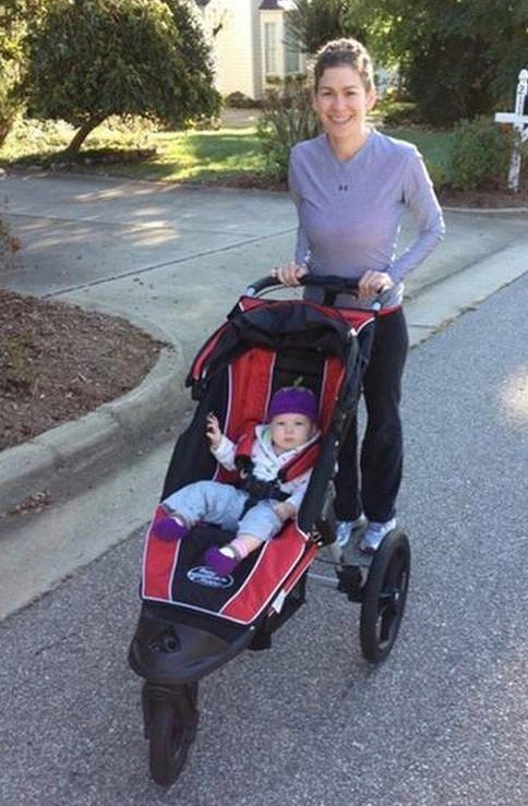 Mom exercising with baby in jogger