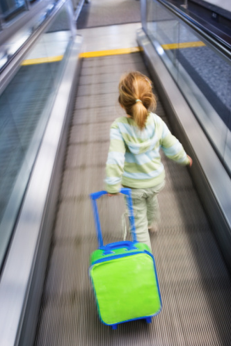 toddler with carry on suitcase