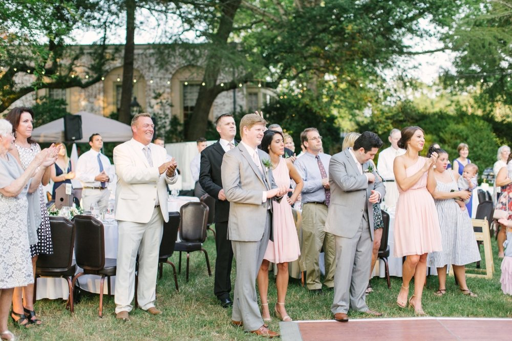 Guests at Korey and Graham's reception look on as they share their first dance as husband and wife. | Photograph: Paige Ryan Photography
