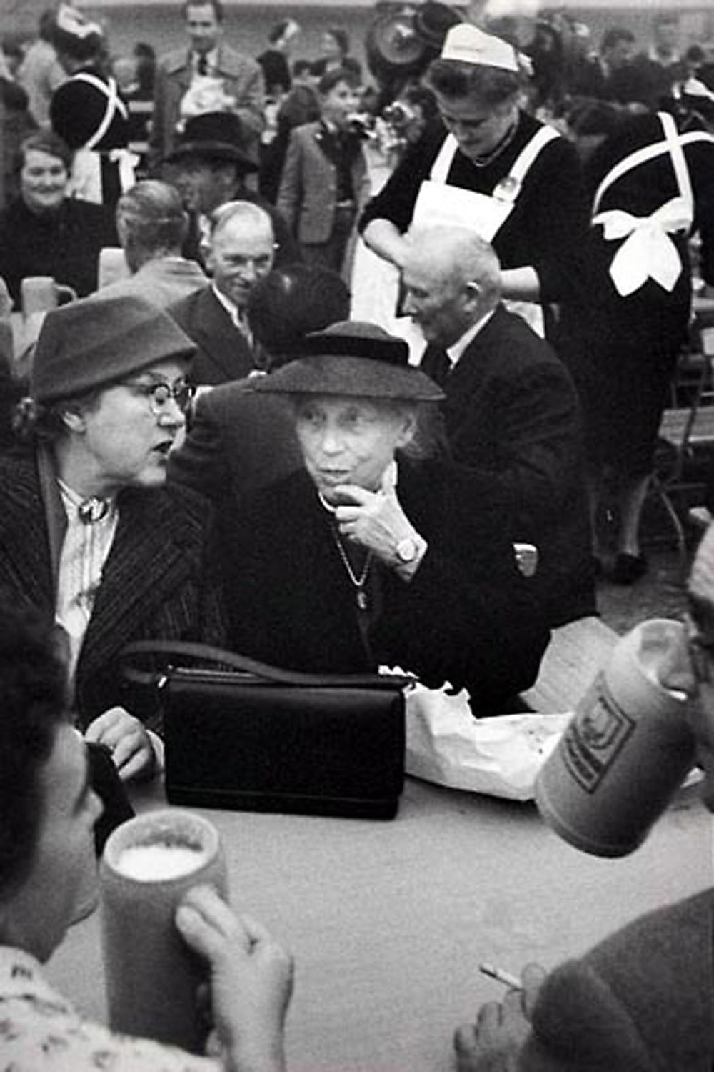 HANNON_two_women_at_octoberfest_(munich)_1957_11x14_high.jpg