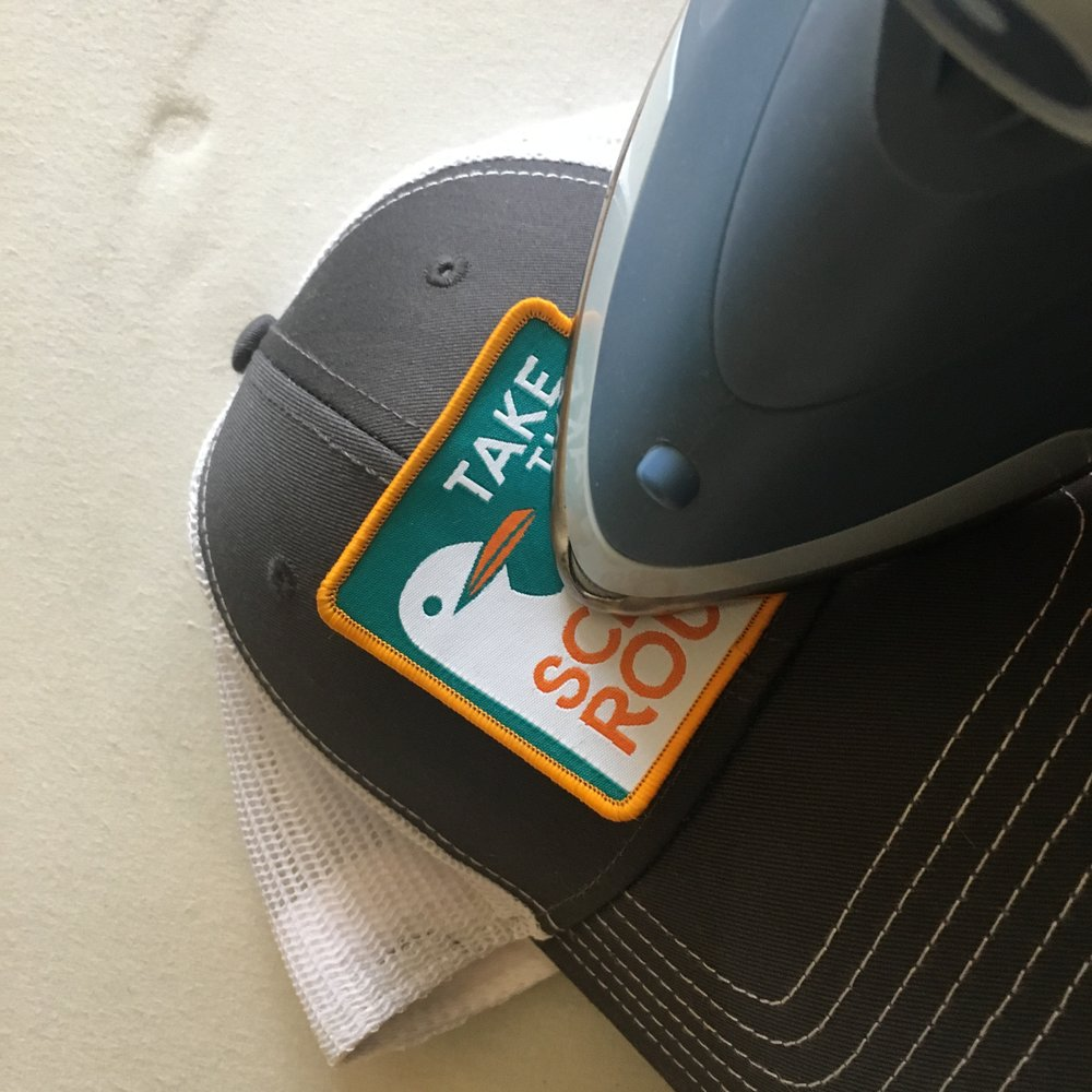 Follow the ironing directions above. Adhering a patch to a hat can be a bit tricky, but you got this!