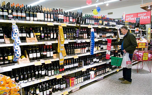 A typical UK supermarket with an old man (not Mr. Pie) clearly lost and confused as he's buying wine not whiskey