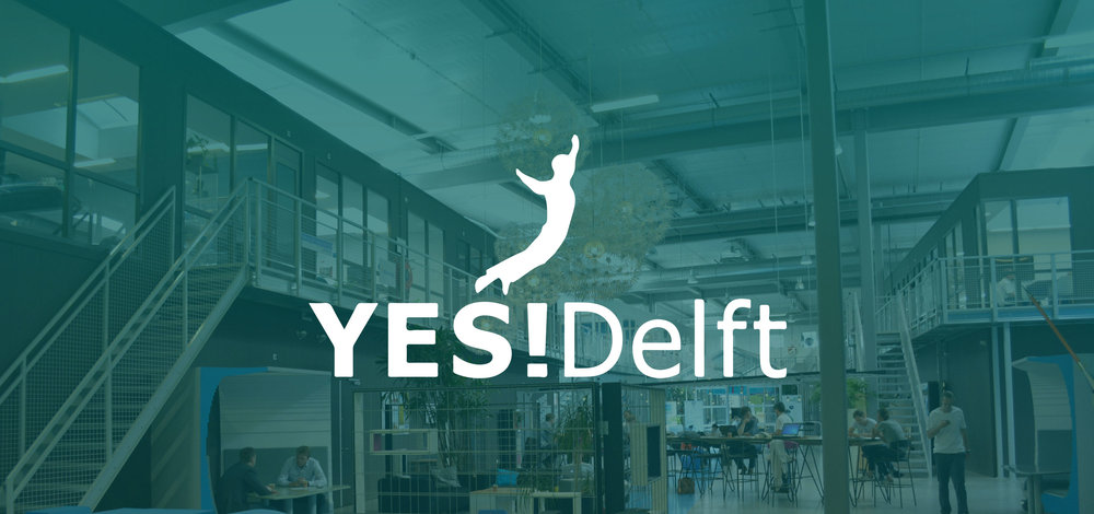 Image of Yes Delft logo superimposed on the image of the main hall of Yes Delft.