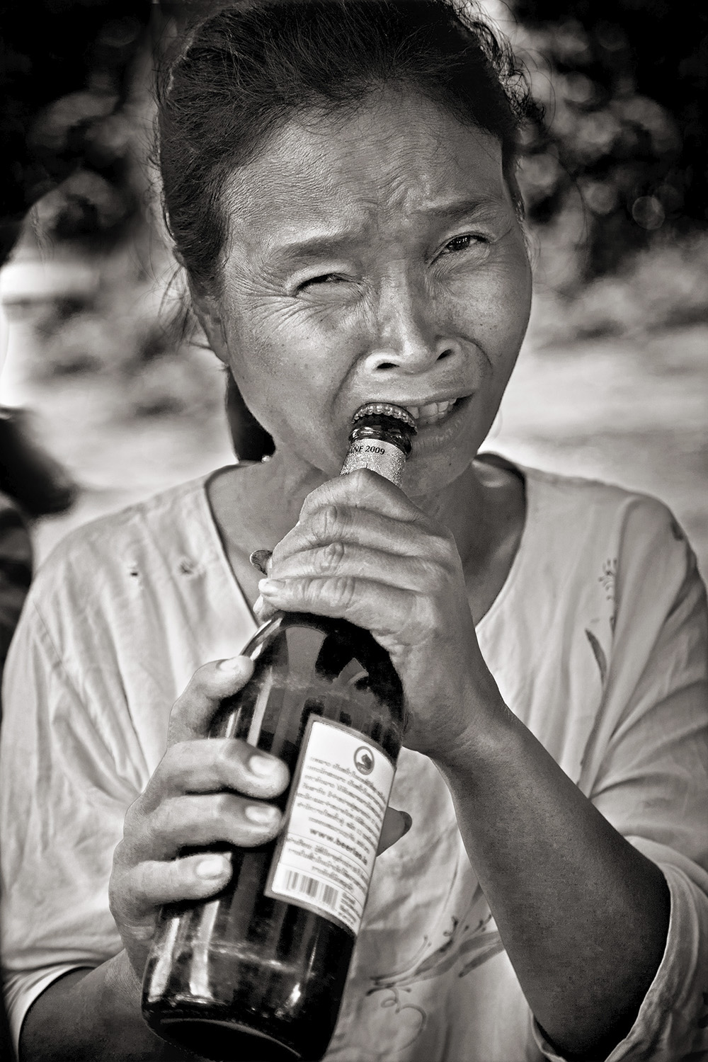 Laos Woman with Beer Bottle